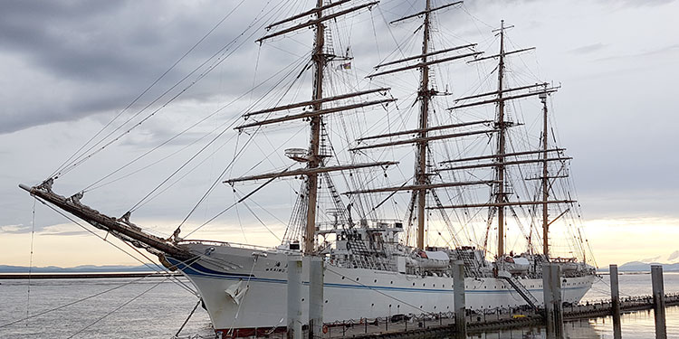 Classically-masted vessel returning to Steveston port